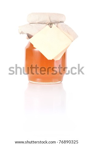 Golden honey jar with empty white tag