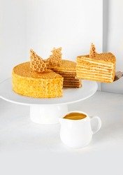Golden honey seven layered cake with honey comb biscuit