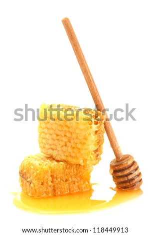 golden honeycombs with honey isolated on white