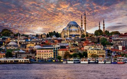 Golden Horn and the skyline of the Old Town of Istanbul city on dramatic sunset, Turkey