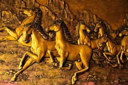 Golden Horses sculptures on the wall