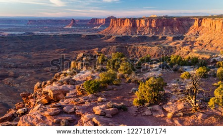 Golden Hour Light on Candlestick Tower and the Island in the Sky from the end of Grand Viewpoint in Canyonlands National Park, Utah.