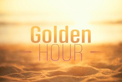 Golden hour words on blur tropical sand beach with bokeh sunlight wave abstract background. Copy space of business summer vacation and travel adventure concept. Vintage tone filter effect color style.