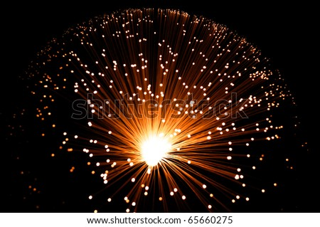 Golden illuminated fibre optic lamp.
