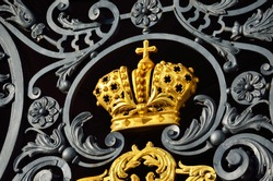 Golden imperial crown on the front gate of the Winter Palace. Saint Petersburg, Russia. History, symbol, national landmark, sightseeing theme