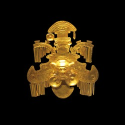Golden indigenous ornament from South America natives with black background (Museo del Oro, Bogota, Colombia)
