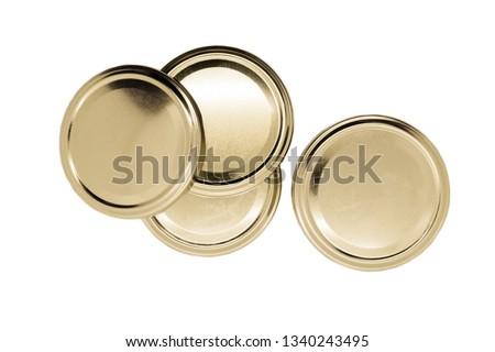 Photo of  Golden jar lids isolated on white background