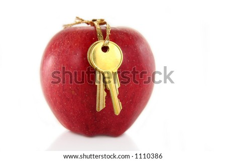 golden key and red apple