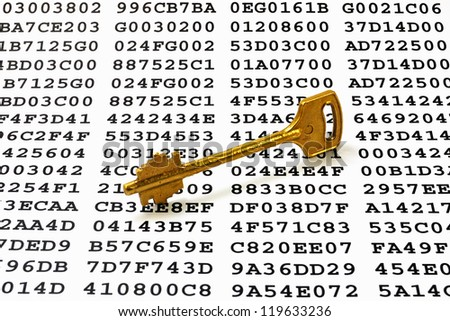 Golden key on a sheet with encrypted data
