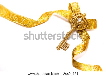Golden key. Shining symbol of a new life, isolated on a white background