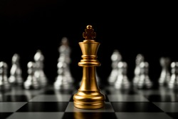 Golden King chess standing in front of other chess, Concept of a leader must have courage and challenge in the competition, leadership and business vision for a win in business games