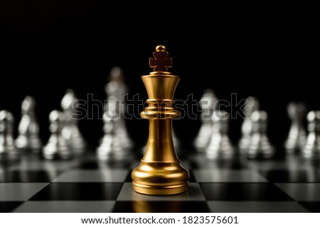 Golden King chess standing in front of other chess, Concept of a leader must have courage and challenge in the competition, leadership and business vision for a win in business games ストックフォト ©