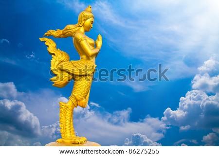 golden kinnara statue in grand palace bangkok thailand