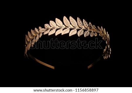 golden laurel wreath headband isolated on black #1156858897