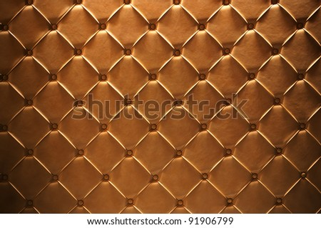 Golden leather texture closeup, useful as background
