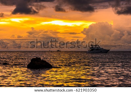 Golden light sunset sea Promthep Cape Thailand #621903350