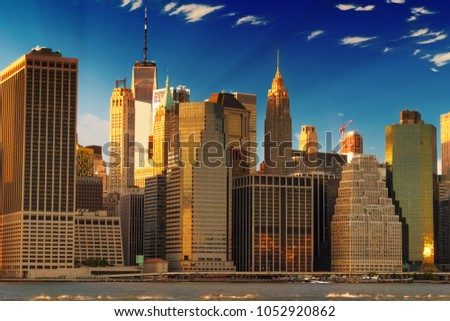 golden Manhattan skyscrapers in financial district after sunset #1052920862