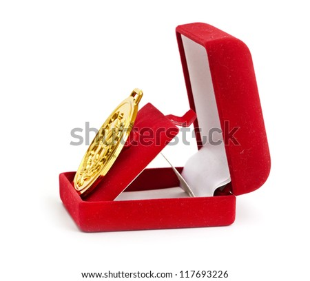 Golden medal in red gift box. - stock photo