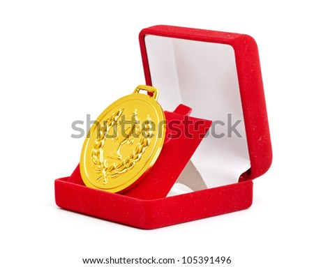 Golden medal in red gift box. white background - stock photo