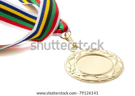 Golden medal on colorful ribbon over white