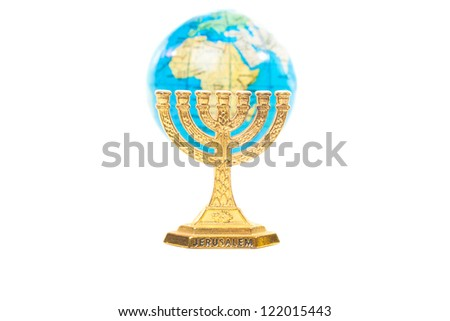 Golden Menorah and small globe in shallow DOF isolated on white background