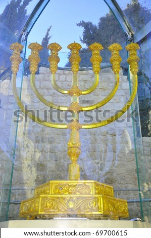 Golden menorah. Old city of Jerusalem.   Over two meters in height and plated with 43 kg  of gold, this menorah is the first such constructed since the destruction of the Temple.