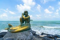 golden mermaid statues on Samila beach. Landmark of Songkla in Thailand.