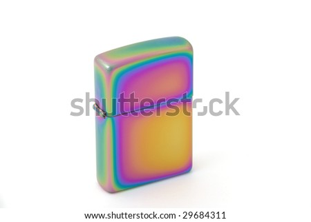 Golden metal cigarette lighter. Selective focus - stock photo