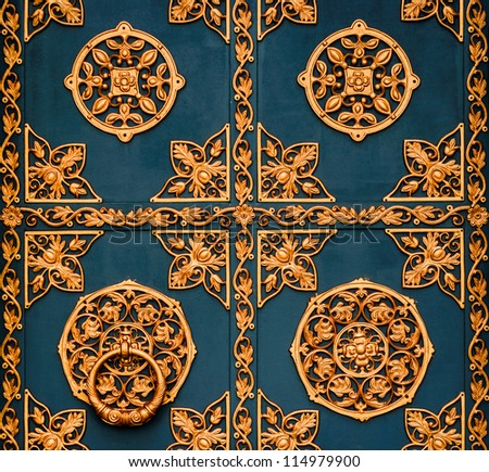 Golden metal lattice on steel background closeup
