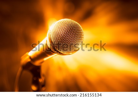 golden microphone on stage #216155134