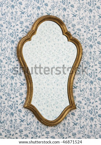Golden Mirror Frame on Wall with Victorian Wallpaper