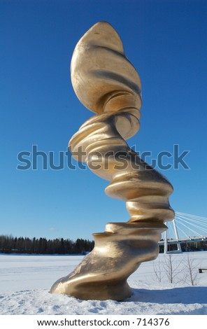 Golden monument along the frozen river in Umea, north of Sweden
