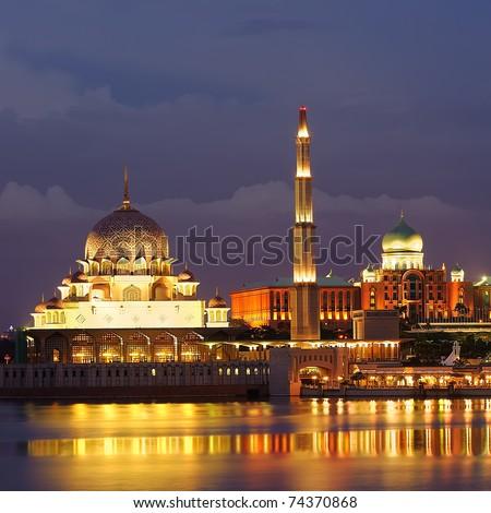 Golden mosque near river in night in Putrajaya, Malaysia, Asia.
