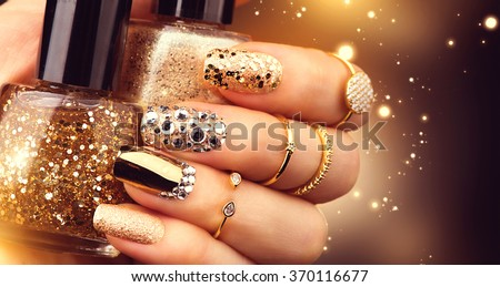 Golden Nail art manicure. Holiday style bright Manicure with gems and sparkles. Bottle of  Nail Polish. Fashion rings with diamonds, Trendy Accessories. Beauty hands. Stylish Nails, Nailpolish #370116677