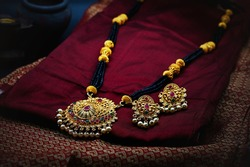 Golden Neckless with earrings clicked with selective focus