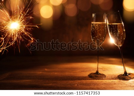 Golden new year background with festive bokeh and tingling champagne  #1157417353