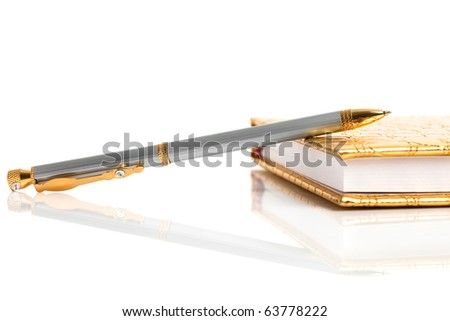 Golden notebook with silver pen