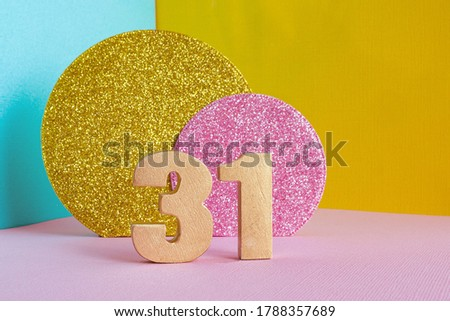 golden number '31' on a multicolored blue-yellow-pink background and two shiny gold and pink circles. happy birthday greeting card concept. Zdjęcia stock ©