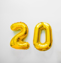 Golden number 20 twenty golden metallic balloon. Party decoration golden balloons. Anniversary sign for happy holiday, celebration, birthday, carnival, new year. Metallic design balloon