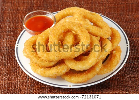 Golden onion rings and ketchup