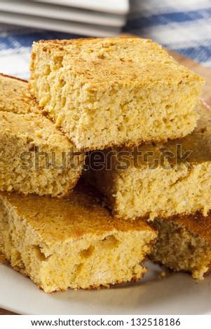 Golden Organic Homemade Cornbread cut into squares - stock photo