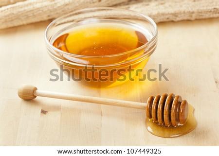 Golden Organic Honey against a back ground