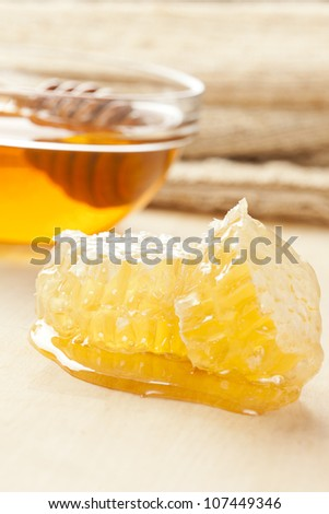 Golden Organic Honey against a back ground