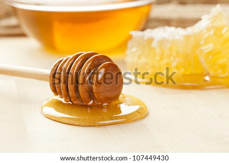 Golden Organic Honey against a back ground - stock photo