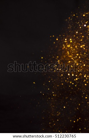 Golden overlay background of golden lights with bokeh effect. Includes copy space. #512230765