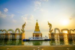 Golden pagoda and king of Nagaes statue at the holy lake of Phayao, Phayao, Thailand