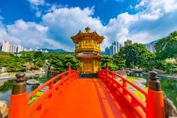 Golden pagoda of Nan lian garden in Hong Kong city with beautiful background