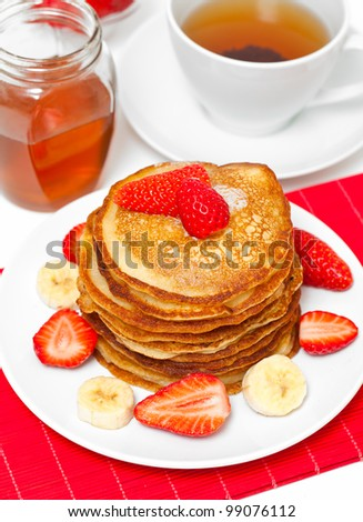 golden pancakes pancakes with honey and cup of tea
