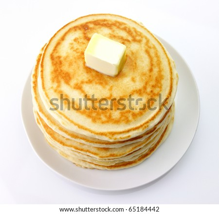 Golden pancakes with butter ,top view