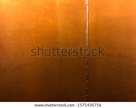 Golden panel frame with hinge in center of two golden panel. Golden panel screen for stage or using background of room decoration.
